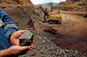 Worker Holding Iron Ore Rock