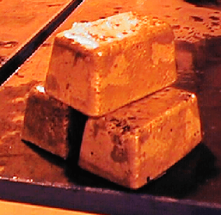 Gold Bullion just extracted from mold