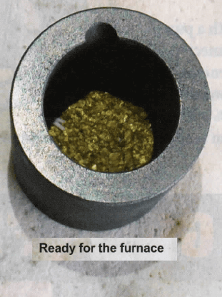 metal melting furnace filled with gold