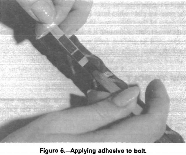 rock bolt applying adhesive